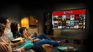 Famiglia che guarda in TV Netflix